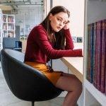 benefits of procrastination - woman at desk