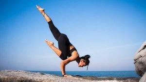 happiness and health - woman doing yoga on a rock.jpg