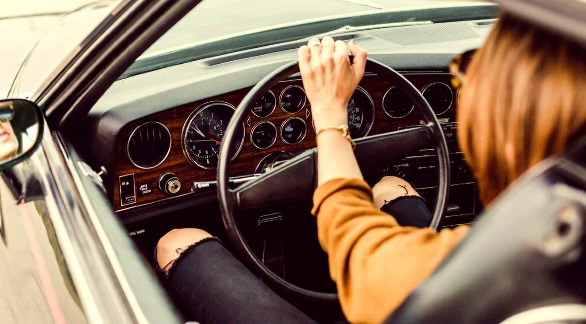 Delaware license plate values - lady in fancy car