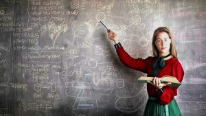 emotional intelligence vs iq - female teacher at blackboard