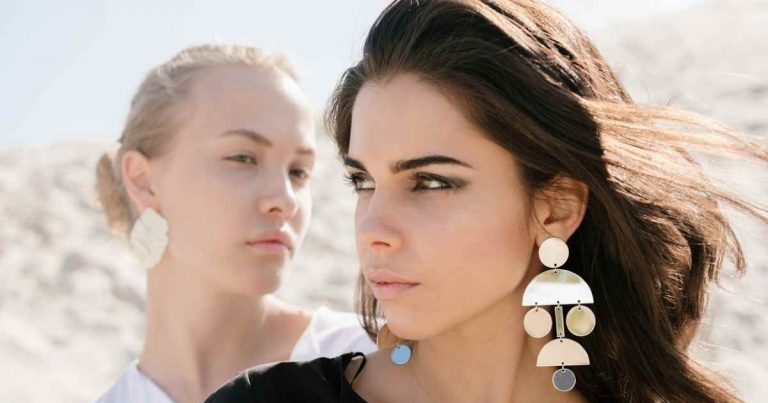 status envy - two girls with earrings