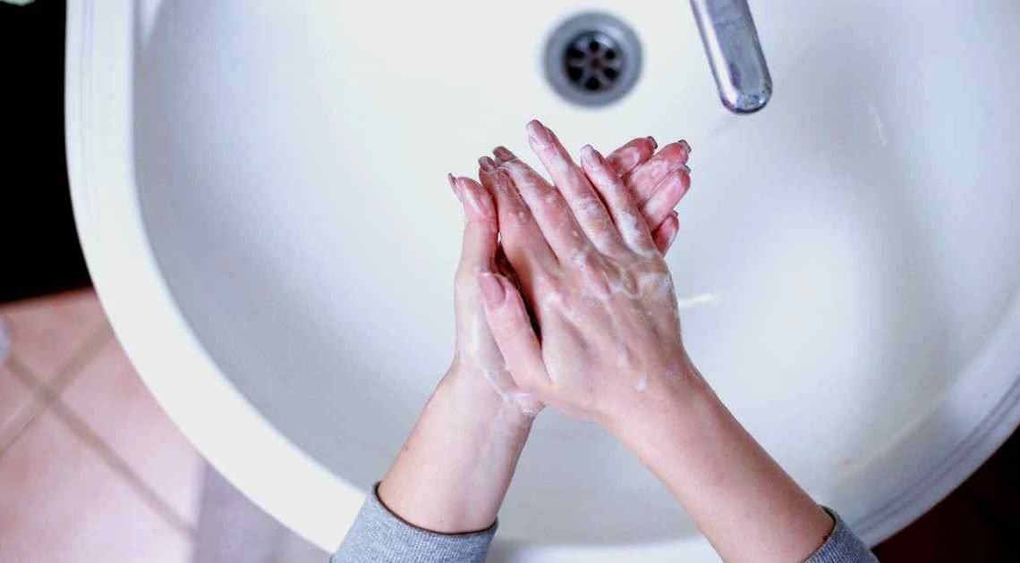 hand dryer - wash hands in sink