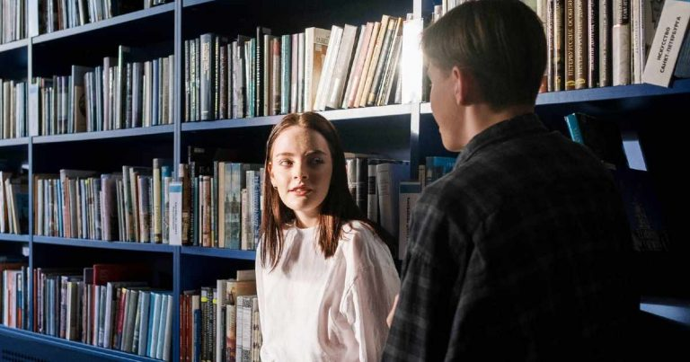 how to flirt - singlehood - man and woman in library
