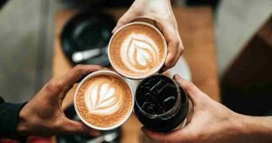 new study about coffee consumption and DNA - three hands drinking coffee