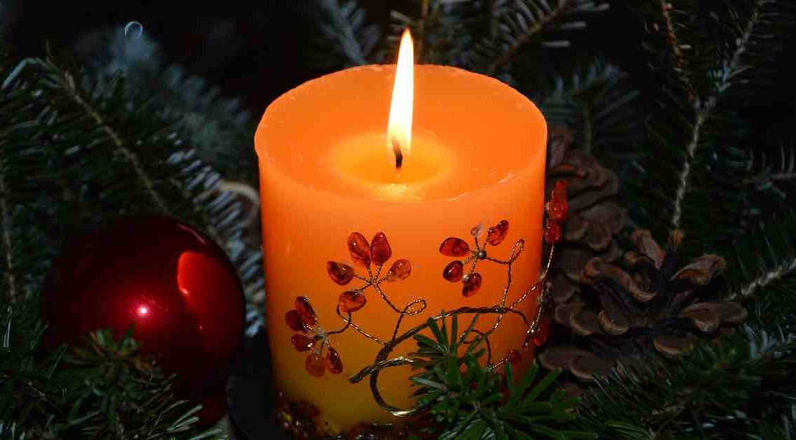 condolences and bereavement messages - red candle by Peggychoucair via Pixabay