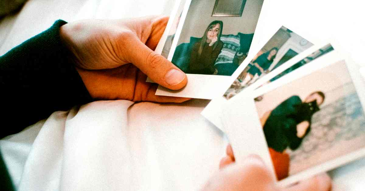 A memory fades the more we think about it - a hand holding old photos