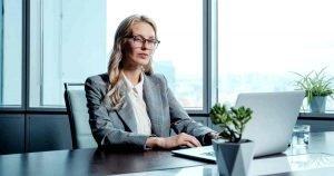 decision fatigue - female bank manager at desk