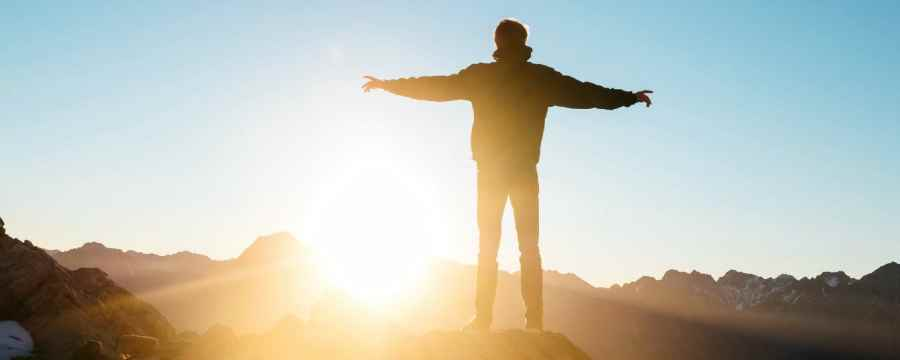 grief quotes, death quotes, and comforting words - man on a mountain