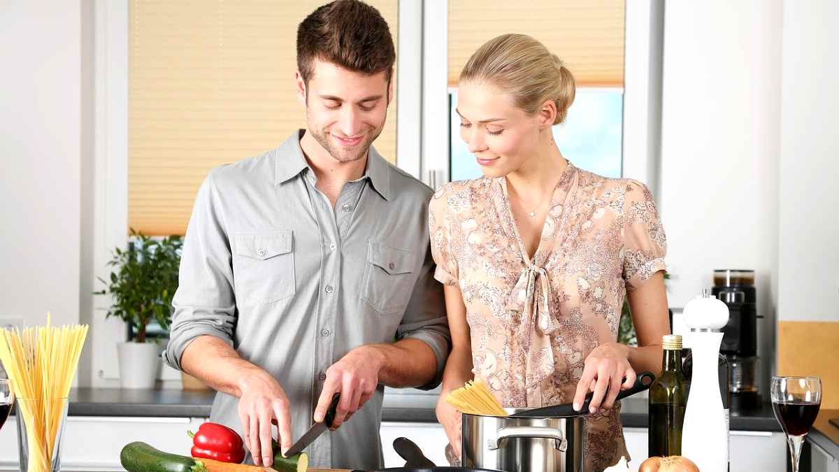 housework and household earnings - man and woman cooking