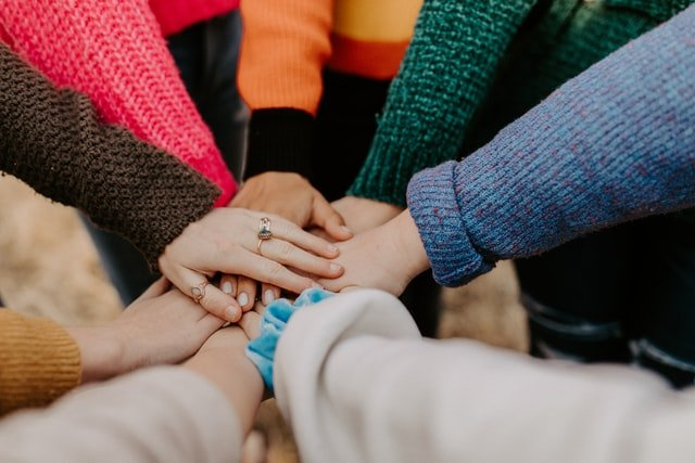 if you fear you have anthrophobia then reach out - hands holding hands - Photo by Hannah Busing on Unsplash