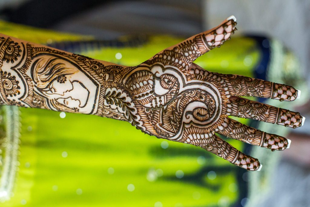 mehndi henna designs - intricate couple on arm and palm