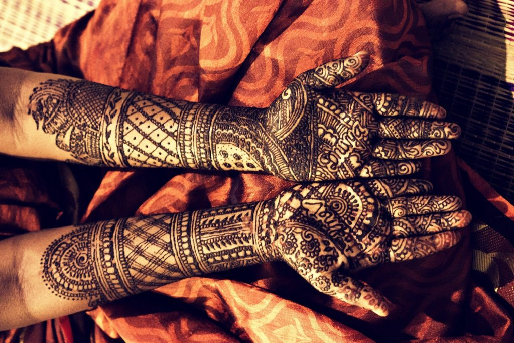amazing full-on mehndi design in dark black - two arms and two hands