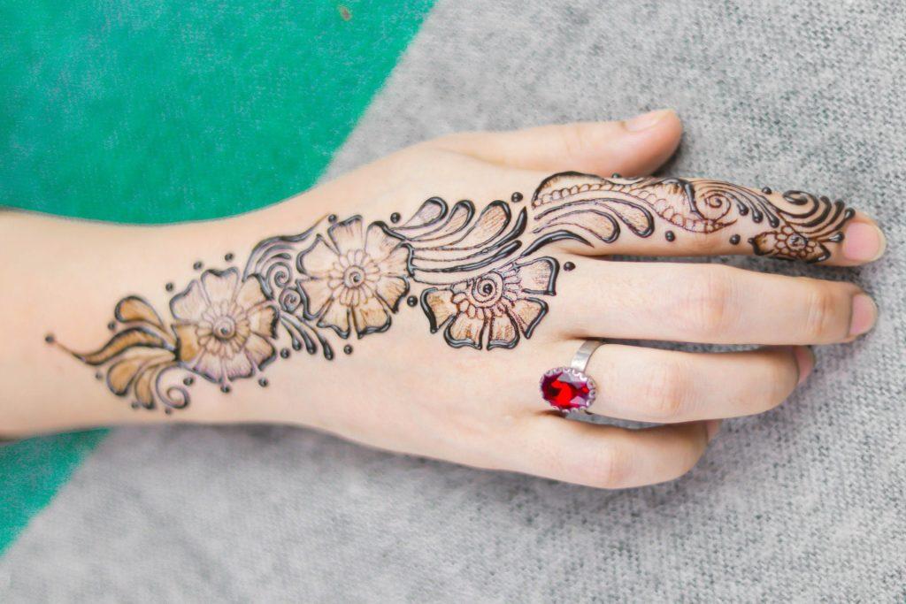 bridal mehndi henna hand tattoo - flowers and tears