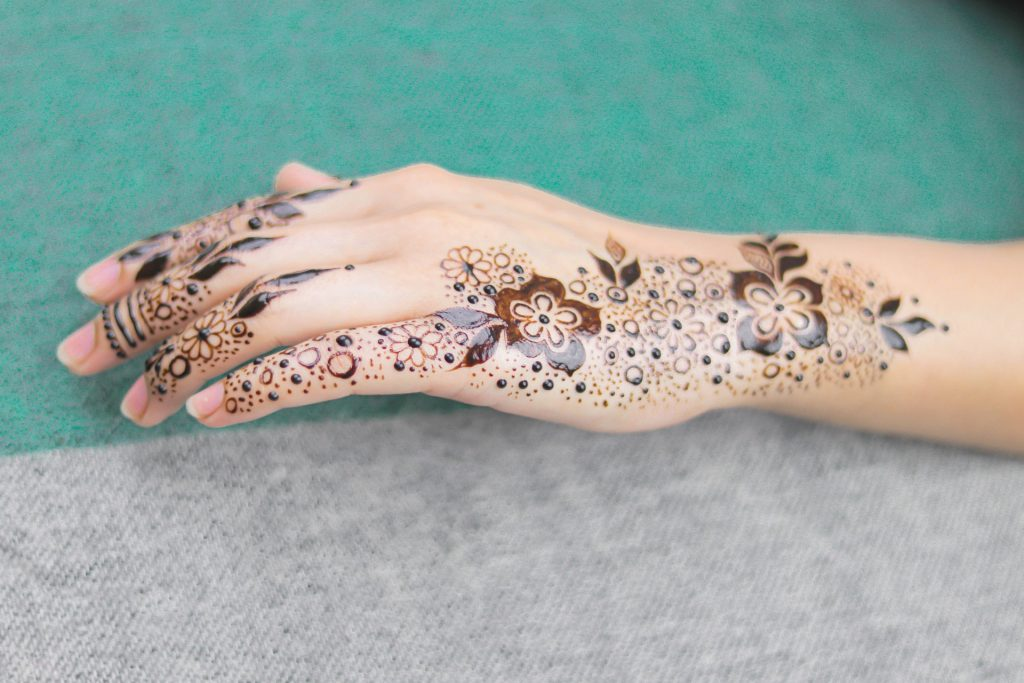 mehndi designs for a wedding - hand with flowers